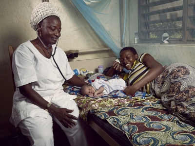 Mother, infant, and nurse in Benin